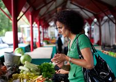 Woman buying vegetables Stock Image
