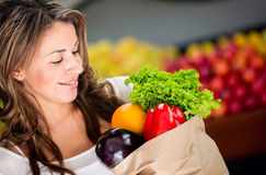 Woman buying vegetables Stock Photography