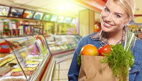 Woman buying vegetables. Woman buying some vegetables. shopping doncept Royalty Free Stock Images