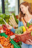 Woman buying vegetables Royalty Free Stock Photography