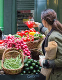 Woman buying vegetables at Bermondsey market Royalty Free Stock Image