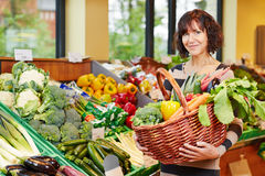 Woman buying vegetables Royalty Free Stock Image