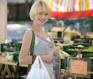 Woman buying vegetables at farmer's market Stock Images