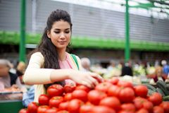 Woman buying vegetables on the market Stock Photo