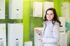 Woman buying  water boiler Royalty Free Stock Photos