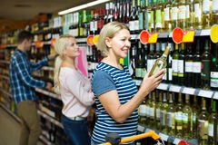 Woman buying wine in supermarket Royalty Free Stock Photography