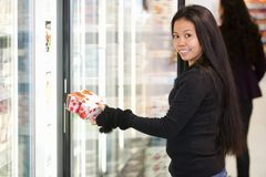 Woman Buying Yogurt Royalty Free Stock Photo
