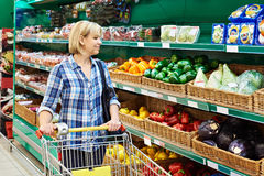 Woman buys bell peppers in store Stock Image