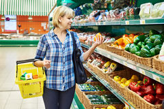 Woman buys bell peppers in store Royalty Free Stock Photography