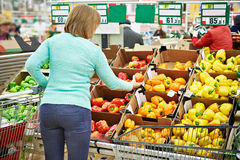 Woman buys a bell peppers in store Royalty Free Stock Photos