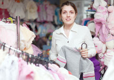 Woman buys clothes for her little daughter Royalty Free Stock Photo