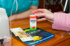 A woman buys Corvalol in the pharmacy Stock Images