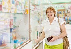 Woman buys drugs at pharmacy Stock Photo