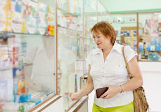 Woman buys drugs at the pharmacy Royalty Free Stock Photography