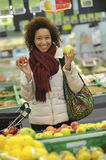 Woman buys fruit and food in supermarket Stock Image