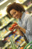 Woman buys fruit and food in supermarket Stock Photo