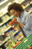 Woman buys fruit and food in supermarket Royalty Free Stock Image