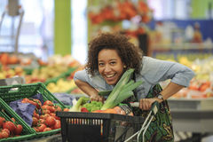 Woman buys fruit and food in supermarket Stock Photography