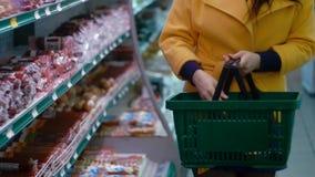 Woman buys a sausage stock video