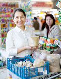 Woman buys the seeds in bag Stock Image