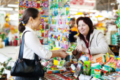 Woman buys seeds in market royalty free stock photo