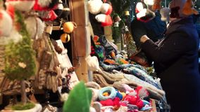 Woman buys souvenirs at  Christmas Fair stock video footage