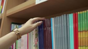 Woman buys stationery. stock video