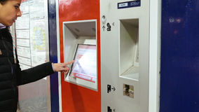 Woman buys tickets at subway station. Hamburg, Germany - October, 10, 2016: Ticket machine in metro subway underground tube is being used by young lady. Woman Royalty Free Stock Photos