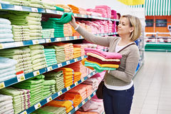Woman buys towels in supermarket Stock Images