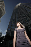 Woman By An Office Tower Royalty Free Stock Photography