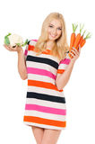Woman with cabbage and carrots Stock Images