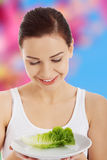 Woman with a cabbage on plate Stock Images