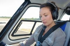 Woman in cabin helicopter before flying Stock Image
