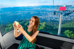 Woman in cable car with cityscape view Stock Photography