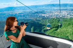 Woman in cable car with cityscape view Stock Image