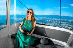 Woman in cable car with cityscape view Royalty Free Stock Images