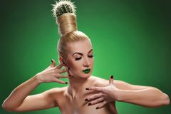 Woman with cactus in her hair Stock Images