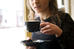 Woman in the cafe. Woman with the cup of the coffee Stock Images