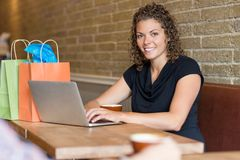 Woman in Cafe with Computer Royalty Free Stock Images