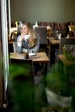 Woman in Cafe Day Dreaming Royalty Free Stock Photos