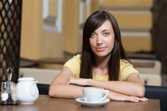 Woman in cafe drink coffee Stock Images