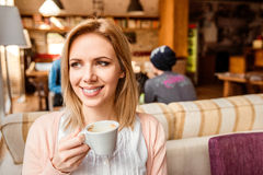 Woman in cafe drinking coffee, enjoying her espresso Royalty Free Stock Photos