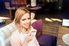 Woman in cafe drinking coffee, enjoying her espresso Royalty Free Stock Image