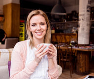 Woman in cafe drinking coffee, enjoying her espresso Stock Photography