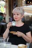 Woman in cafe drinking coffee Stock Photography
