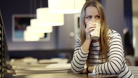 Woman in the cafe drinking tea and waiting for Royalty Free Stock Photo