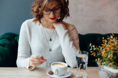 Woman in a cafe Stock Images