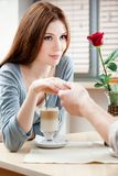 Woman at the cafe hand in hand with her boyfriend Royalty Free Stock Image