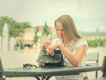 Woman in a cafe looking things in my bag. stock photos