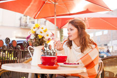 Woman in cafe outdoor Stock Images